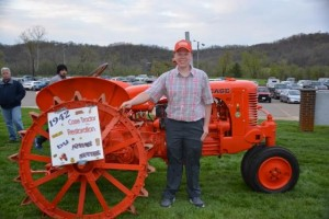 Senior Josiah Nutter, Federal Hocking High School class of 2015, with his senior project, a restored 1947 case tractor.